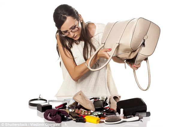 A survey has found34.5 per cent of Aastralian women spend 81 days over their lifetime searching for things in their handbags (stock image)